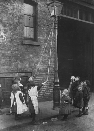 Swinging on a lampost: c.1900