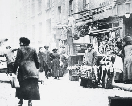 A Whitechapel street with market stalls: c.1900