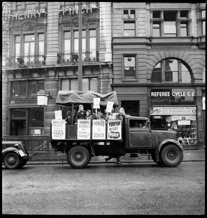 Young protestors drive past Chancery Lane station on May Day