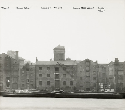 Thames Riverscape showing Roneo Wharf,  London Wharf,  Crown Mill Wharf and Eagle Wharf: 1937