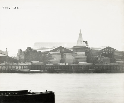 Thames Riverscape showing West India Docks & John Lenanton & Son Ltd Timber Merchants and Importers.; 1937