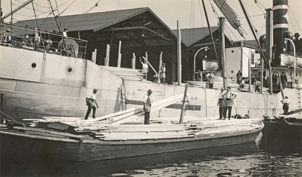 Steamer unloading cargo in Surrey Docks; 1930