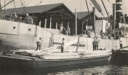 Steamer unloading cargo in Surrey Docks; 1930