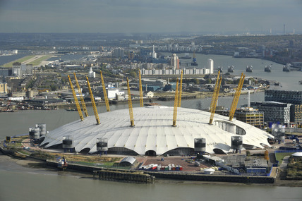 The O2 Arena or Millennium Dome with London City Airport in the distance;