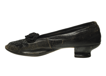 Emmeline Pankhurst's black leather shoe: c.1910