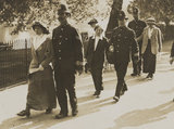 Suffragettes 'After the fight' (four unknown women and three unknown Policemen)