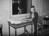 Madeleine Carroll holding a John Bull pen