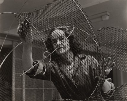 Barbara Hepworth at work on the armature of a sculpture