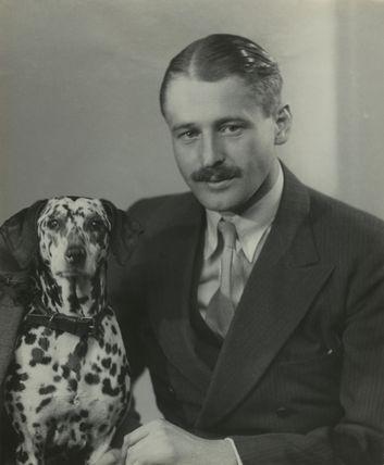 (Ninian) John Frederick Hanbury-Tracy with his dog