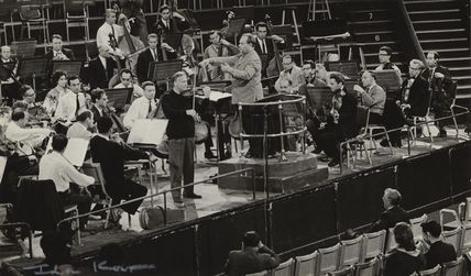 Yehudi Menuhin in rehearsal with an orchestra