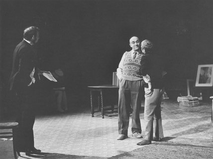 Sir Peter Hall; Warren Mitchell and an unknown actress