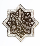 Tile in the form of eight-pointed star