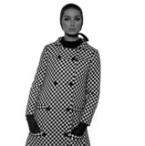 Tania Mallet in checked jacket