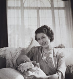 Princess Elizabeth holding her baby son Prince Charles