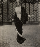 Model wearing a fur shawl over a chiffon dress , by Lucile