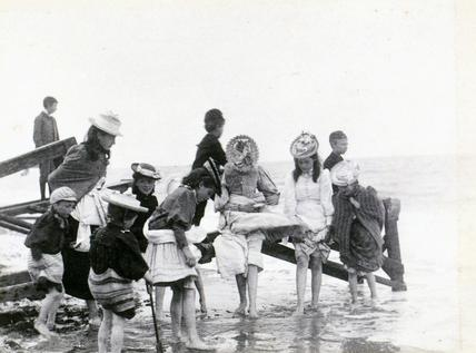 Girls paddling at Yarmouth beach