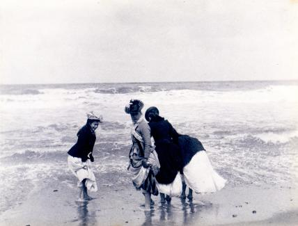 Girls paddling at Cromer