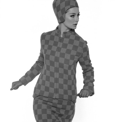 Tania Mallet in chequered outfit and hat