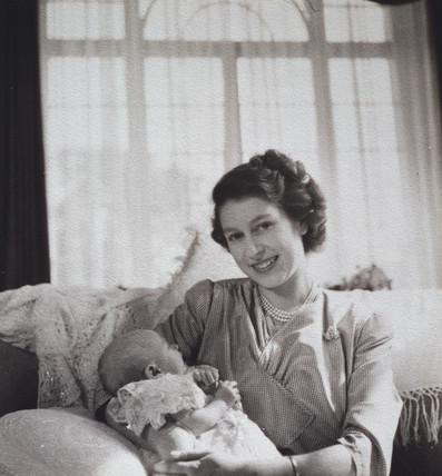 Princess Elizabeth holding her baby son Prince Charles