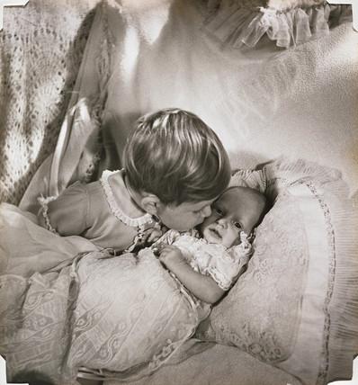 Prince Charles kissing baby Princess Anne