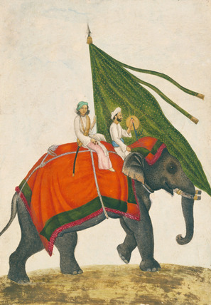 Elephant with a Mahout carrying a green standard with a gold sun on its back