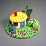 Hut and garden model made from extruded playstuff, 1996.