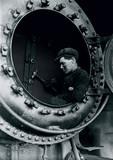 Man in a firebox, c 1925.