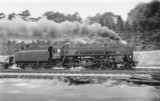 Panning shot of a 9F 2-10-0 locomotive, No 92204, September 1964.