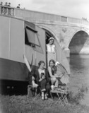 Women having tea by Chertsey Bridge, Surrey, 11 April 1931.