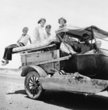 Migratory family travelling acros the desert on US Highway 70, May 1937.