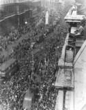 Crowds of people celebrating V E Day in
