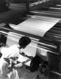 Woman worker boarding nylon stocking, 26 Ma