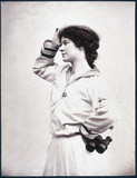 Woman posing in a sailor suit holding a pair of binoculars, c 1880-1899.