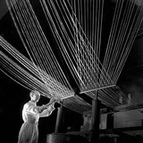 Terylene proces worker with thread pattern, ICI Billingham, 1955.