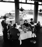 Manchester Airport, family in restaurant with BEA Vanguard behind, 1965.