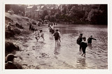 Children playing in a river, c 1900