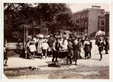 Children gather near a park, c 1900.