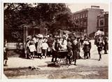 Children gather near a park, c 1900.