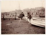 Two boys on the prow of a boat, Whitby, c 1905.
