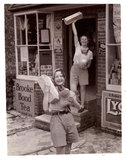 """Two women carrying loaves of bread, c 1935."""""""
