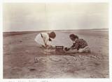 'Kodak' sandcastle on the beach, c 1910.