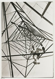 Man climbing a pylon, c 1930.
