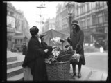 Flower seller in Piccadilly Circus, 1932.