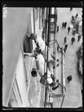Painters working in a cradle, Whitehall, London, 1932.