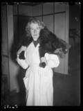 Woman carrying a fox over her shoulders, 1937.