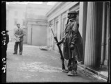 Soldier on guard wearing a chemical warfare suit, 1938.