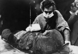 Pathologist examining the mask of a mummy, Manchester, 10 June 1975.
