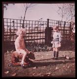 Children playing in a garden.