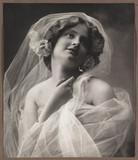 Woman in veil, c 1906.