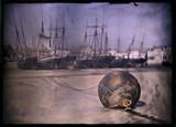 A rusty buoy, c 1908.